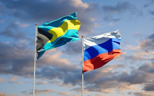 Schöne nationalstaatsflaggen von russland und von bahamas zusammen auf blauem himmel. 3d-grafik