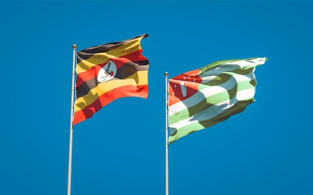 Schöne nationalstaatsflaggen von uganda und abchasien zusammen