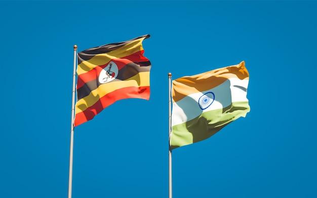 Schöne nationalstaatsflaggen von uganda und indien zusammen