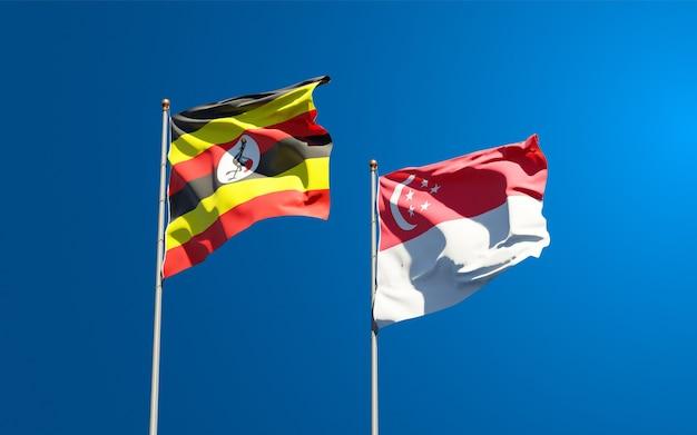 Schöne nationalstaatsflaggen von uganda und singapur zusammen