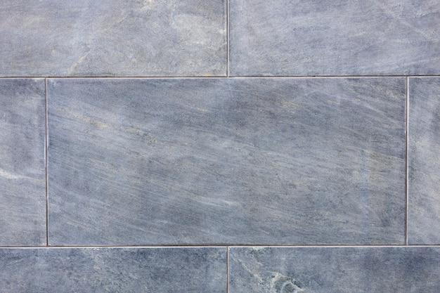 Schöne steinmauer graublau. hintergrund für den designer. substrat. foto in hoher qualität