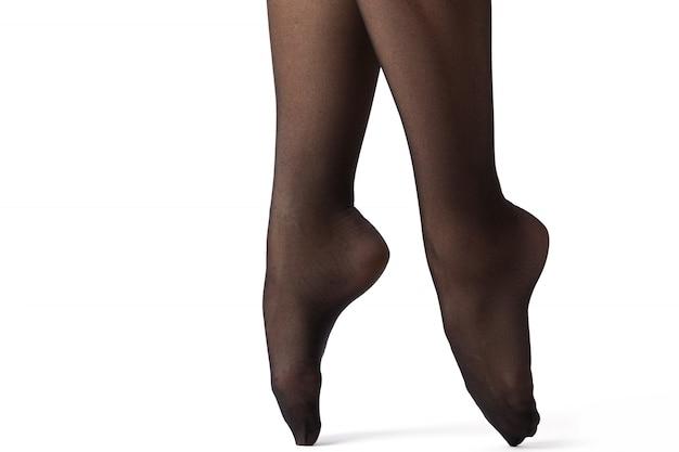 Schöne weibliche beine in schwarzen strümpfen