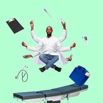 Schöner afrikanischer arzt, mehrarmiger mann, der isoliert auf grünem studiohintergrund mit ausrüstung schwebt. konzept der beruflichen tätigkeit, arbeit, job, medizin, gesundheitswesen. multitasking wie shiva.