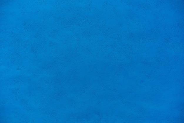 Schöner dunkelblauer zementwandhintergrund der grunge.