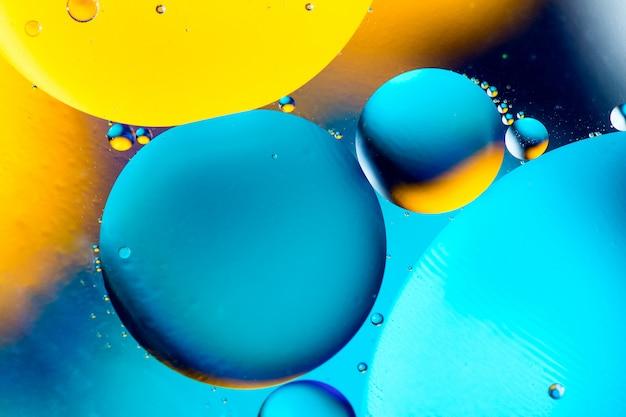 Schöner farbzusammenfassungshintergrund von gemischtem wasser und von öl.
