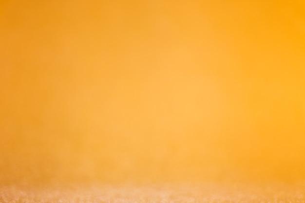 Schöner gold defokussierter glitzerhintergrund mit kopienraum