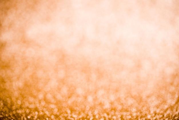Schöner goldener glänzender hintergrund. glitter hintergrund.