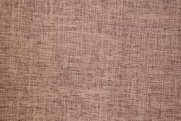 Schöner grauer strukturierter hintergrund aus nahaufnahmematerial, möbelstoff