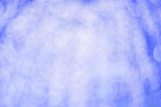 Schöner hintergrund auf pastellfarbtonsteigung mit abstraktem bokeh licht