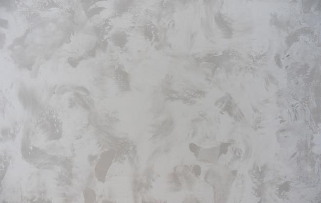 Schöner hintergrund vom dekorativen venezianischen stuck der texturnahaufnahme auf der wandoberfläche grau