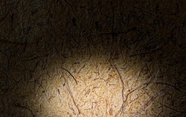 Schönes braunes und schwarzes maulbeerpapier für den hintergrund.