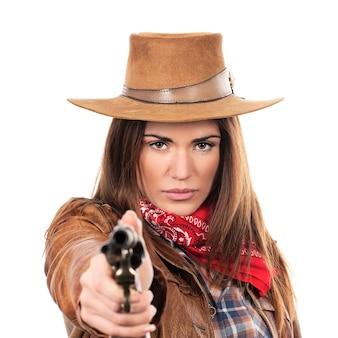 Schönes cowgirl mit pistole