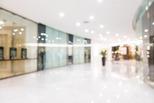 Schönes luxuseinkaufszentrum der abstrakten unschärfe und einzelhandelsspeicher