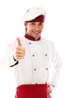 Schönes porträt des jungen kochs lächelnd