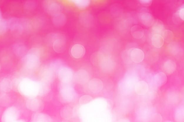 Schönes rosa bokeh aus fokushintergrund heraus