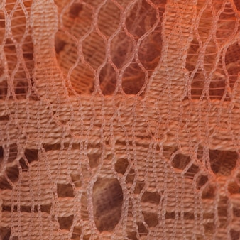 Schönes textilmaterial in feiner masche in rötung
