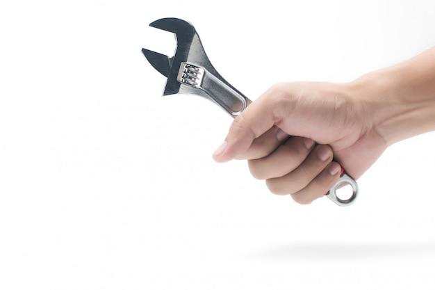 Schraubenschlüssel, schraubenschlüssel. hand, die einen metallschlüssel auf weiß hält