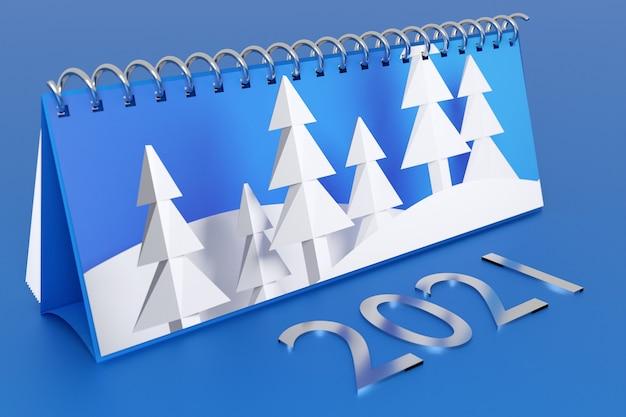 Schreibtischkalender notizbuch mit inschrift und weißen nadelbäumen