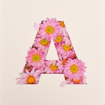 Schriftdesign, abstrakte alphabetschrift mit rosa blume, realistische blumentypographie - a.