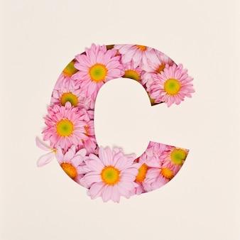 Schriftdesign, abstrakte alphabetschrift mit rosa blume, realistische blumentypographie - c.