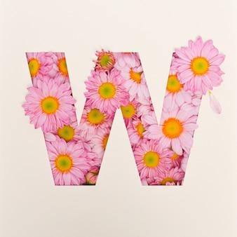 Schriftdesign, abstrakte alphabetschrift mit rosa blume, realistische blumentypographie - w.