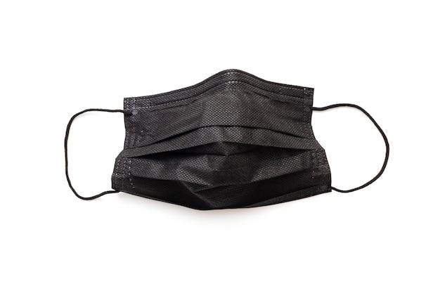 Schützende, schützende schwarze maske, isoliert auf weiss. schwarze gesichtsmaske für starken dresscode.