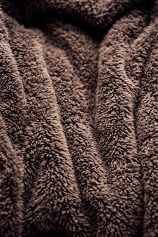 Schuss der abstrakten pelzhintergrundbeschaffenheit. graue farbtextur des abstrakten stoffes