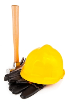Schutzhandschuhe und hammer des schutzhelms