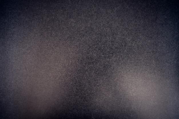 Schwarz gehämmerte metallplatte. hintergrund textur tapete