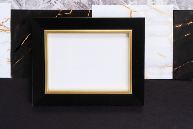 Schwarz-goldener mok-up-rahmen, art-deco-stil der 20er jahre