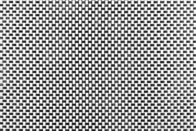 Schwarz-weiß-abstraktes wicker-muster rattan-textur-hintergrund extreme nahaufnahme