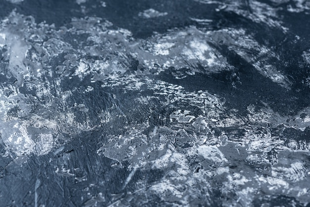 Schwarz-weiß-hintergrund mit matter oberfläche. textur