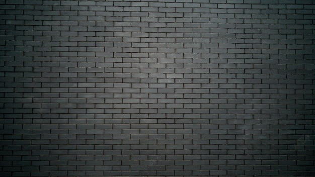 Schwarz-weißer hintergrund mit schwarzer backsteinmauer