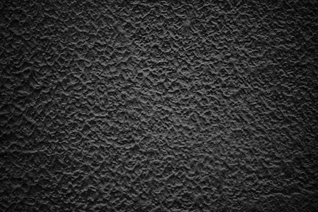 Schwarze abstrakte wand, dunkle zementbeschaffenheit als hintergrund