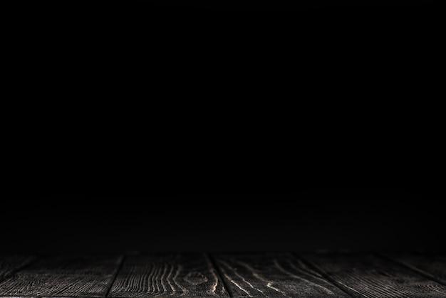 Schwarze arbeitsplatte auf schwarzem hintergrund