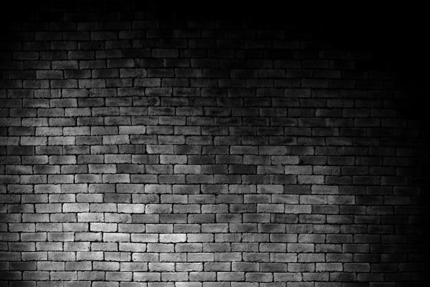 Schwarze backsteinmauer, maurerarbeithintergrund