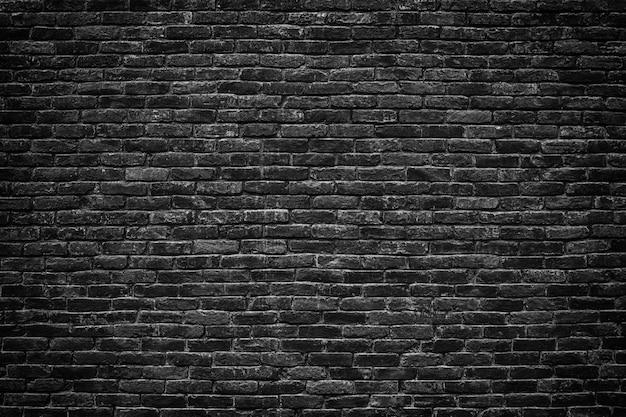 Schwarze backsteinmauer mit retro-effekthintergrund für design