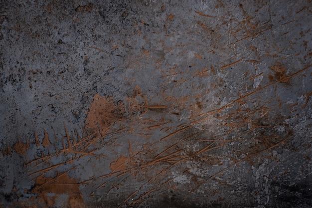 Schwarze betonwandbeschaffenheit raue rostige schnitte. hintergrund für das menü oder den bildschirmschoner