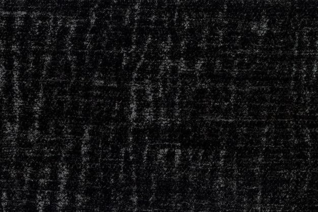 Schwarze, flauschige oberfläche aus weichem, flauschigem stoff