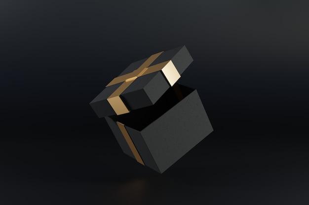 Schwarze geschenkbox mit goldener dekoration auf schwarzem hintergrund.