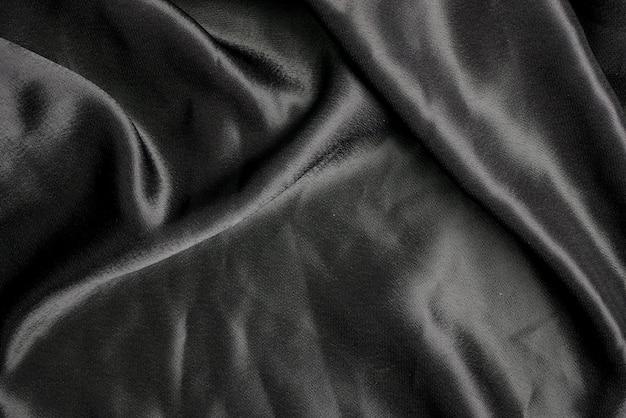 Schwarze gewebestoff-hintergrundbeschaffenheit