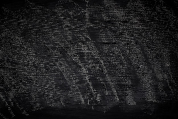 Schwarze grunge beschaffenheit mit copyspace. abstrakte kreide auf tafel gerieben.