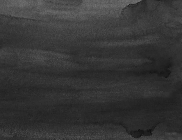 Schwarze hintergrundbeschaffenheit des aquarells. dunkle monochrome überlagerung. abstrakte alte aquarellmalerei. flecken auf papier.