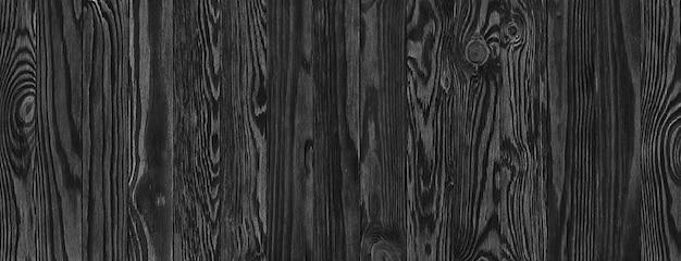 Schwarze holzbretter, ein panorama der holzstruktur mit natürlichen mustern