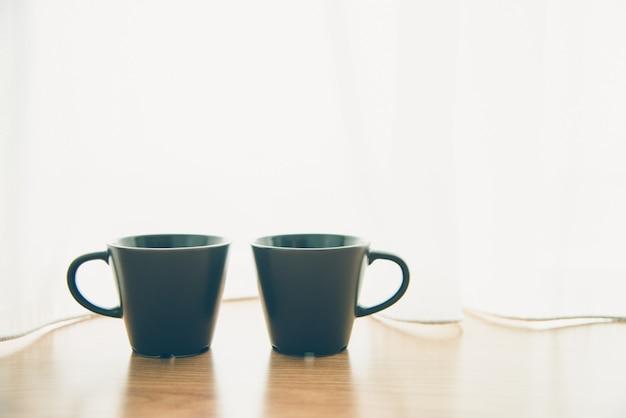 Schwarze kaffeetasse