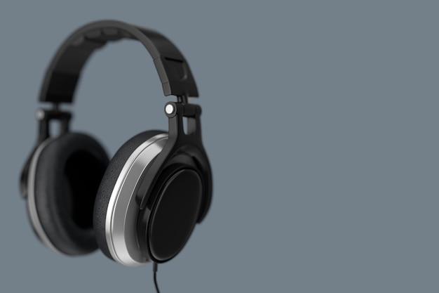 Schwarze kopfhörer auf grauem hintergrund. 3d-rendering