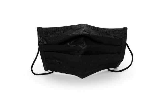 Schwarze medizinische maske auf isoliertem weißem hintergrund