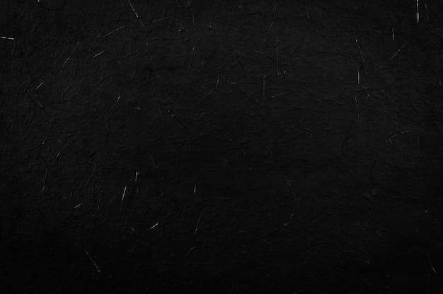 Schwarze papierbeschaffenheit oder hintergrund, papier von der natur für für hintergrundzusammensetzung