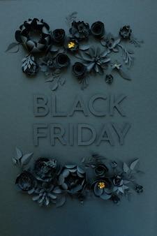Schwarze papierblumen auf schwarzem hintergrund