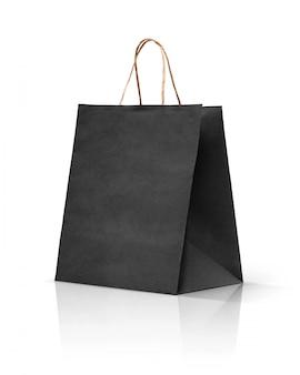 Schwarze papierkraftpapier-einkaufstasche lokalisiert auf weißem hintergrund